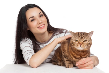 ginger cat: beautiful smiling brunette girl and her ginger cat over white background