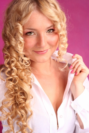 beautiful blonde girl with curly hair photo