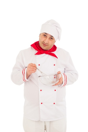 smiling chef holding whisk and transparent bowl weraing red and white uniform over white background  photo
