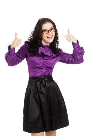 beautiful smiling brunette woman wearing shirt, skirt and glasses over showing thumbs up over white background  Stock Photo