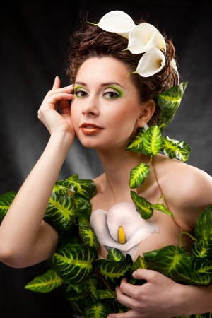 beautiful girl with body art and white flowers in hair
