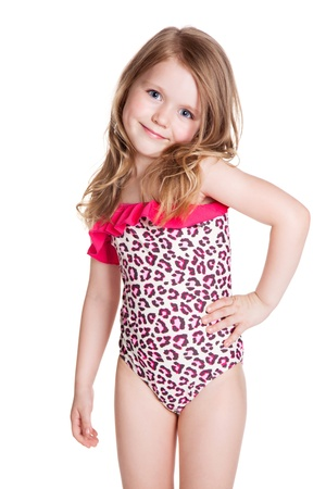 little blonde happy girl in pink swimsuit over white background