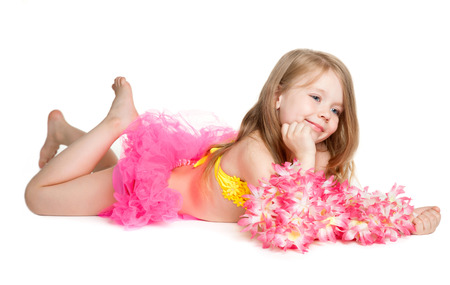 little happy girl wearing pink skirt, yellow swimsuit, flowers holding sun glasses over white background