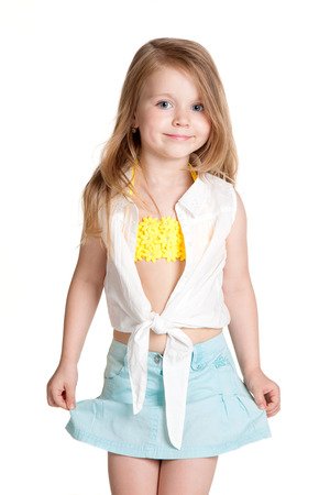 little girl wearing blue skirt over white background