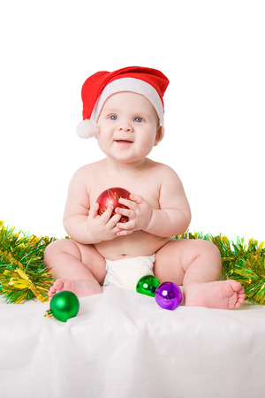 santa clause hat: little boy wearing Santa Clause hat holing christmas tree toy over white backgdoung