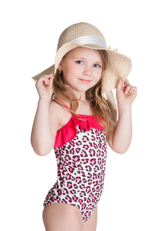little girl swimsuit: little blonde happy girl in pink swimsuit holding hat over white background