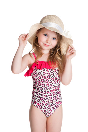 little blonde happy girl in pink swimsuit holding hat over white background photo