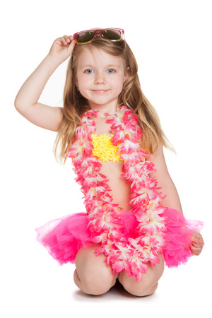 little happy girl wearing pink skirt, yellow swimsuit, flowers holding sun glasses over white background  photo