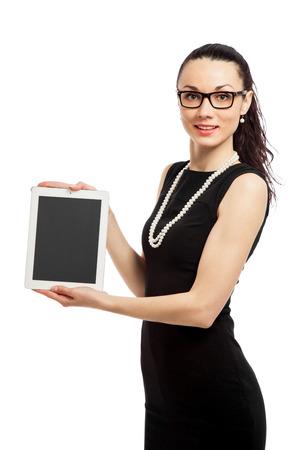 brunette girl in black dress hodling touchpad over white background