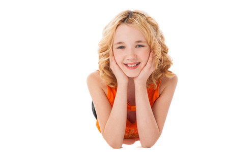 little smiling girl in orange clothes  over white background Stock Photo