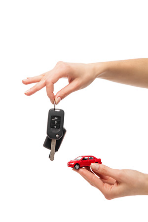 Car Key Concept Illustration : Two hand holding exchanging red colored car with automatic key