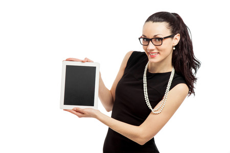 brunette girl in black dress holding ipad over white background photo