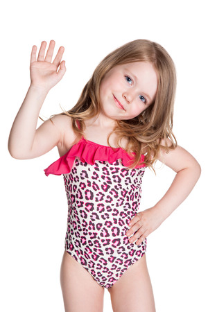 little blonde happy girl in pink swimsuit over white background photo