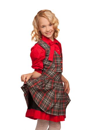 kleine blonde Mädchen tragen karierten Kleid isoliert auf weiß Standard-Bild