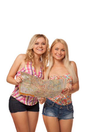 two beautiful blonde girls wearing jeans shorts with map isolated on white