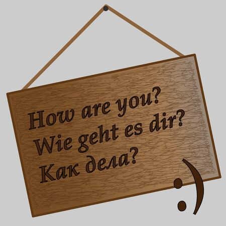 Brown wooden plate with inscription How are you in English. German and Russian