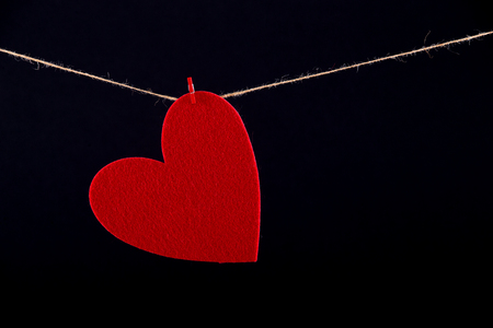 pack string: Red paper heart hanging on the clothesline