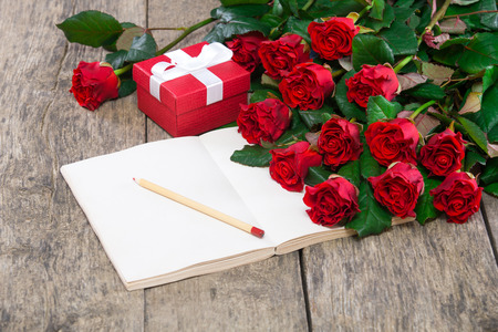 symbolic: hearts and a bouquet of red roses on wooden board, Valentines Day background