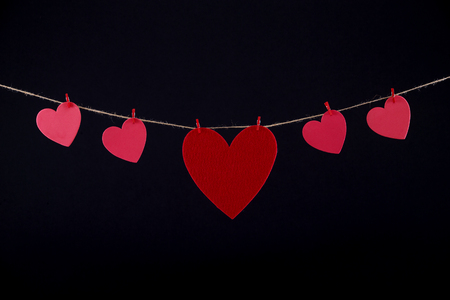 paper heart: Red paper heart hanging on the clothesline