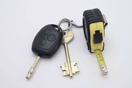 Car key and charm  roulette on the white photo