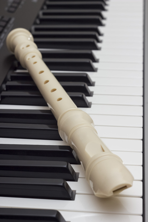 flute structure: The blokfluit On The Synthesizer close up Stock Photo