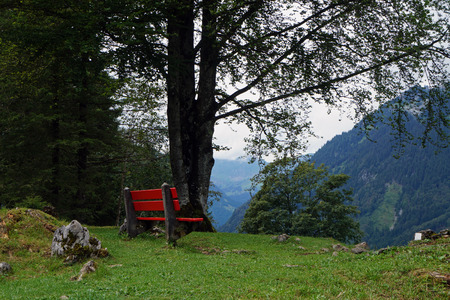 glarus: Bench in the mountains above Klontalersee, in canton Glarus, Switzerland Stock Photo