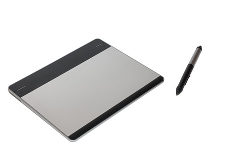 wacom: Graphic tablet with a feather isolated on white