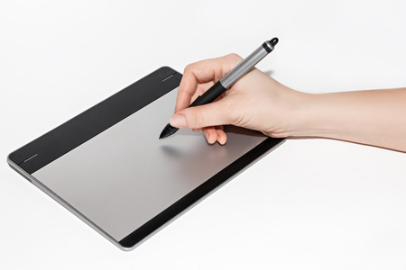 wacom: Graphic tablet, hand holding a feather isolated on white