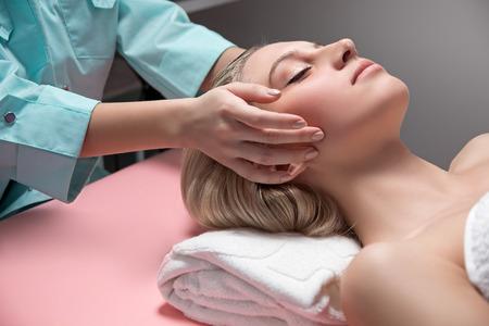 cosmetician: Cosmetician doing receiving facial massage