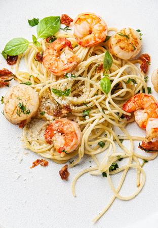 pasta dish: Spaghetti with prawns, sea scallops and basil