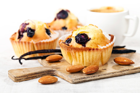 blueberry muffin: Three Homemade Blueberry Muffin cupcakes on white