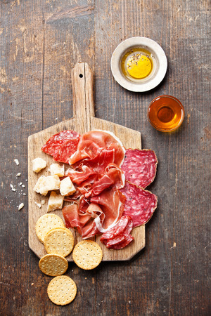 Chopping board of Assorted Cured Meats, Cheese and Honey Stock Photo