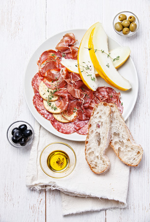 Platter of Assorted Cured Meats and Melon Banque d'images