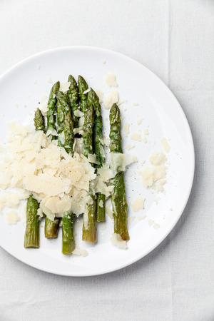 Asparagus with Parmesan cheese on white background Archivio Fotografico