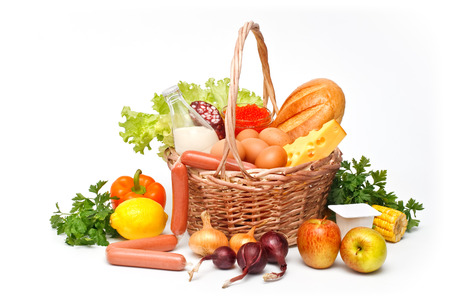 Basket of goods with daily products on white background photo