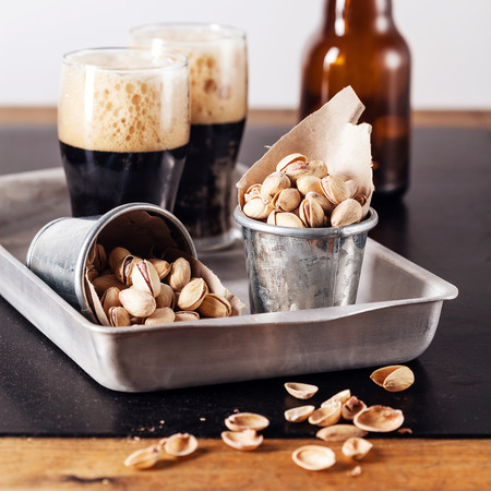 beerglass: Dark beer and salted pistachios