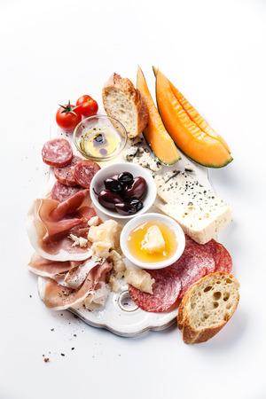 Antipasti ham, cheese, melon, olives, olive oil, bread