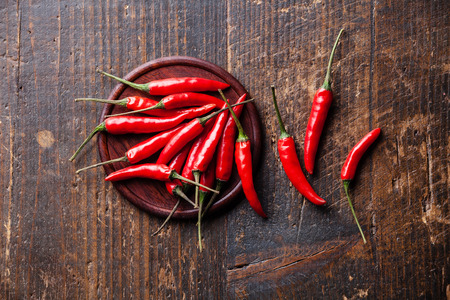 Red Hot Chili Peppers on wooden background Archivio Fotografico