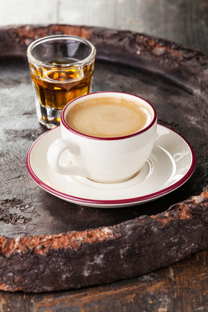Coffee laced with brandy on dark background photo