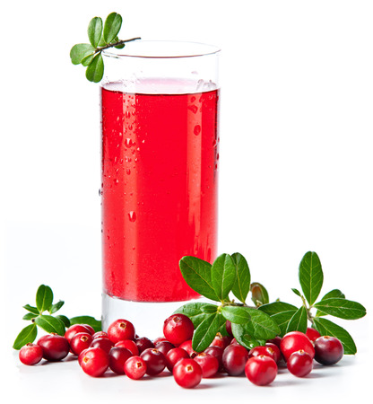 Fruit drink made from cranberries with leaves on white background Imagens