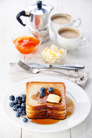 French toast with blueberries, maple syrup and butter Reklamní fotografie