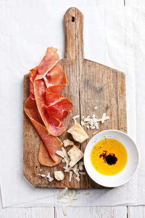 prosciutto: Cured Meat, Cheese and bread Stock Photo