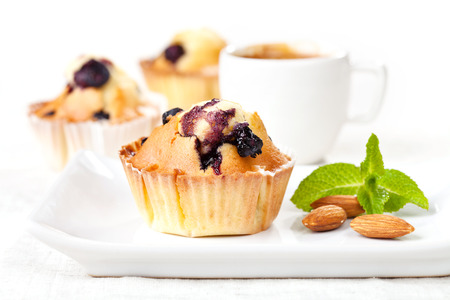 blueberry muffin: Three Homemade Blueberry Muffin cupcakes on white background