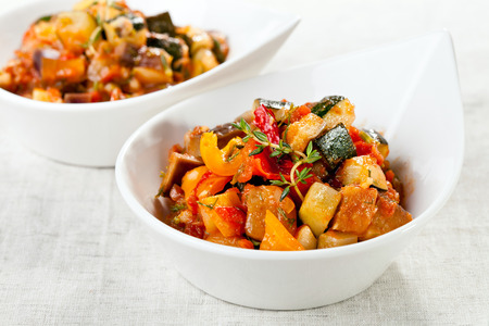 Traditional vegetable ratatouille on white background Imagens