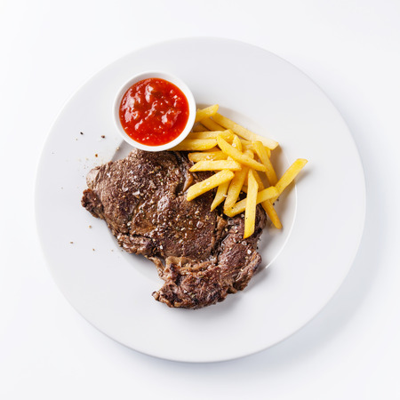 Roast beef with Salted french fries on white plate on white background