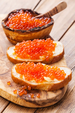 Sandwiches with Salmon red caviar on wooden background Reklamní fotografie