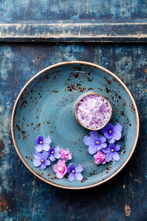 Flowers in blue bowl with sea salt for SPA