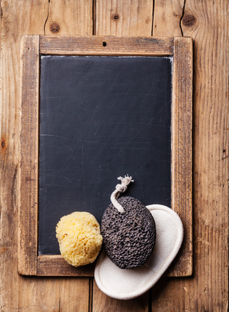Bath Spa Setting with pumice and natural wild sponge on chalk board Reklamní fotografie