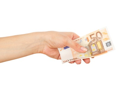 Fifty euro in the womans hand, on the light background