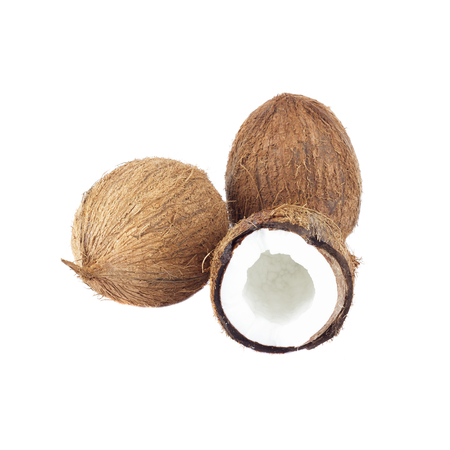 Whole and a half of coconuts isolated on the white Stock Photo